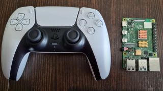 A Raspberry Pi 4 and a DualSense controller side by side