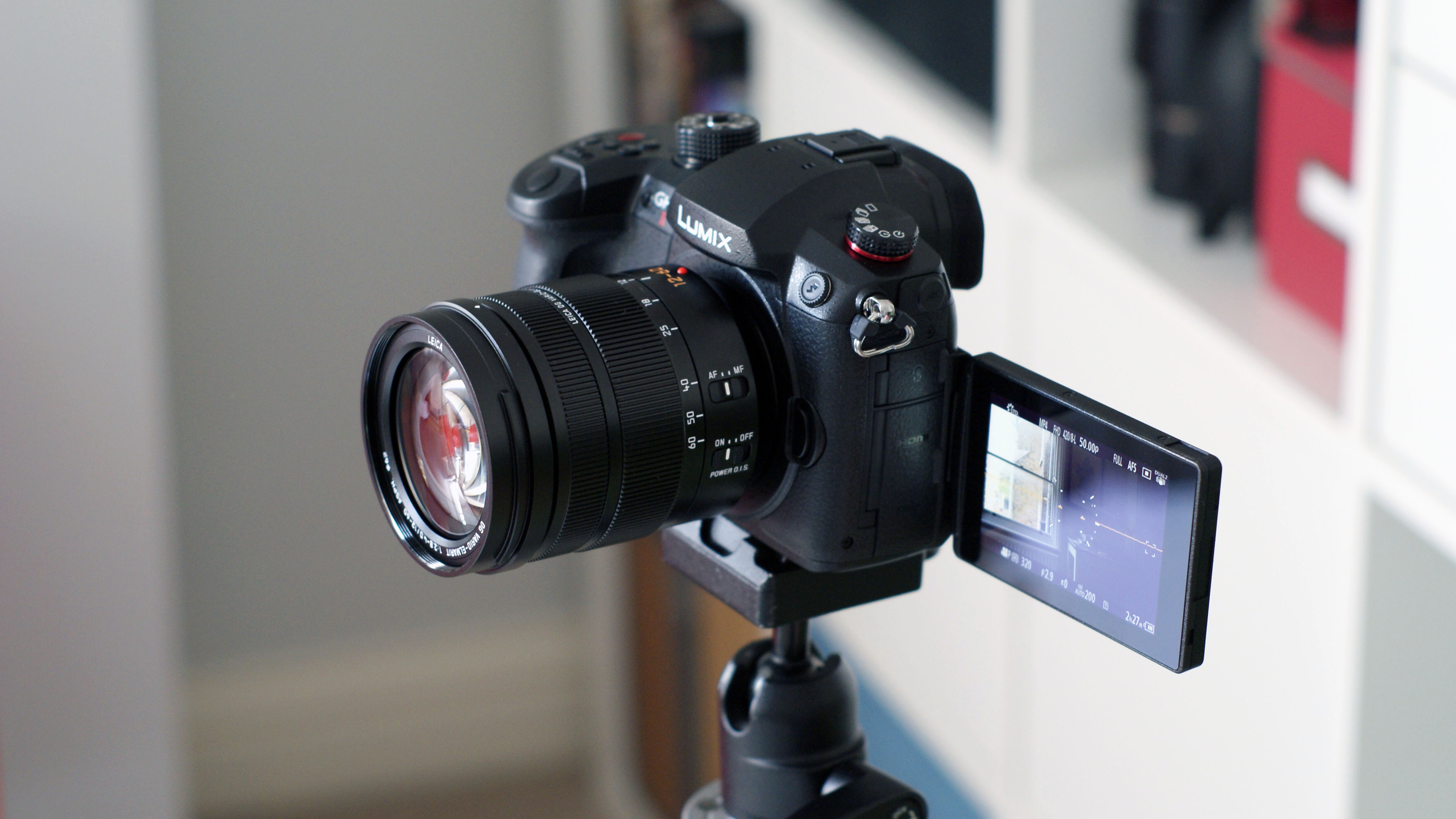 The Panasonic GH5 Mark II vlogging camera mounted on a tripod with its touchscreen pulled out
