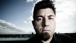 A close-up of Chino Moreno standing on a roof