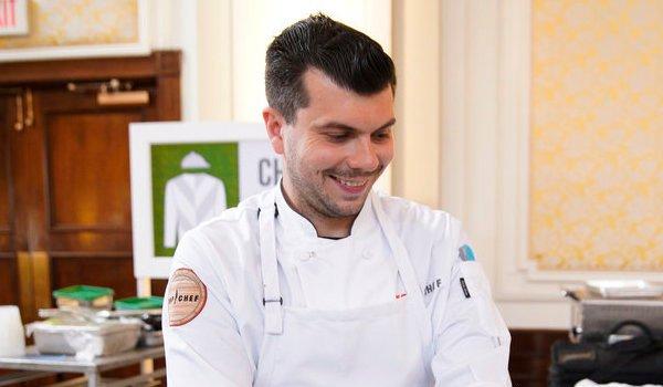 top chef eddie konrad smiling in the kitchen