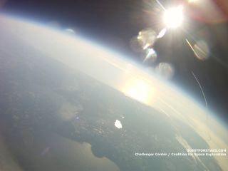 This picture, taken at an altitude of about 64,000 feet by a balloon launched as part of a student project, shows NASA's space shuttle Endeavour streaking toward space on its final STS-134 mission.