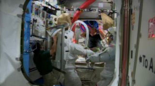 Astronauts Mastracchio and Hopkins Test Spacesuits on ISS