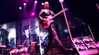 Josh Homme onstage at the KROQ Almost Acoustic Christmas show
