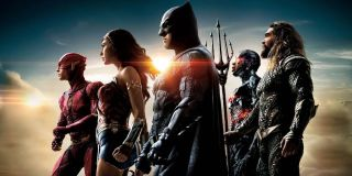Justice League cast lined up in side profile, with the sun shining behind them