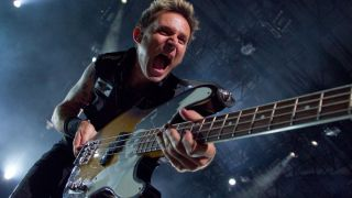 Mike Dirnt of Green Day performs at the The Verizon Wireless Amphitheater on August 31, 2010 in Irvine, California
