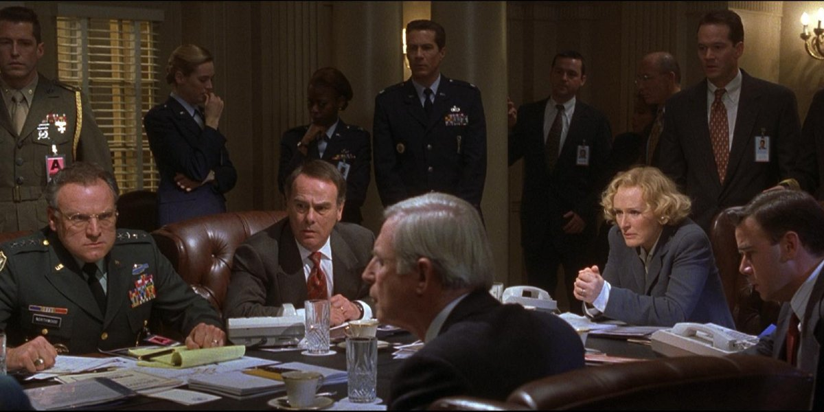 The cabinet discussing plans in Air Force One