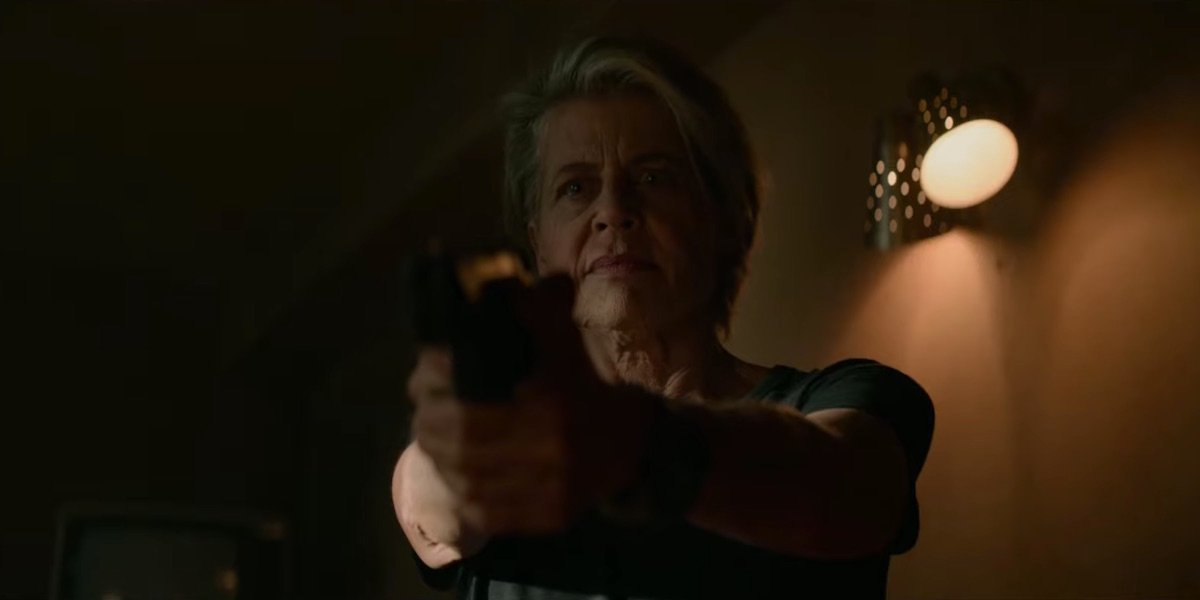 Linda Hamilton holding gun in Terminator: Dark Fate