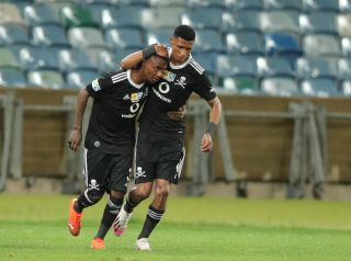 Thembinkosi Lorch celebrates his goal with Vincent Pule
