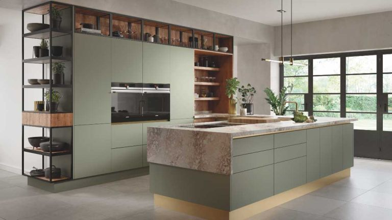 Sage green kitchens can be given an industrial edge with wood and metal