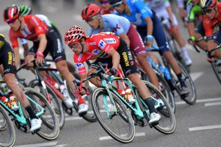 Primoz Roglic in the red leader's jersey on the final stage of the 2019 Vuelta a Espana