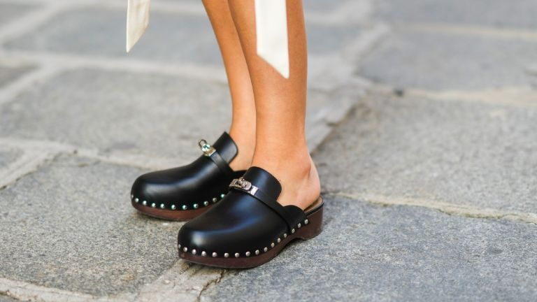 Xenia Adonts wears black leather Hermes studded clogs / shoes, during the Twilly By Hermes : Launch Party In Paris, on July 01, 2021 in Paris, France