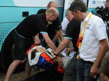 Tony Martin being moved by stretcher from the team bus to the waiting ambulance an hour after the finish