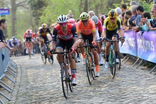 The riders attack the cobbles