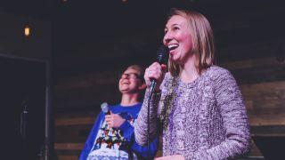 Two woman singing karaoke