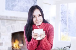 A woman wears a red sweater