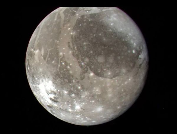 The Jupiter moon Ganymede, the largest satellite in the solar system, as seen by NASA's Voyager 2 spacecraft on July 7, 1979, from a distance of 745,000 miles (1.2 million kilometers).