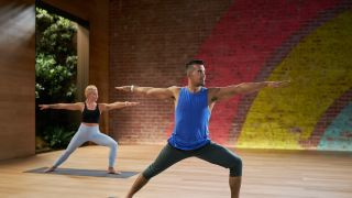 Instructors leading yoga class on Apple Fitness Plus