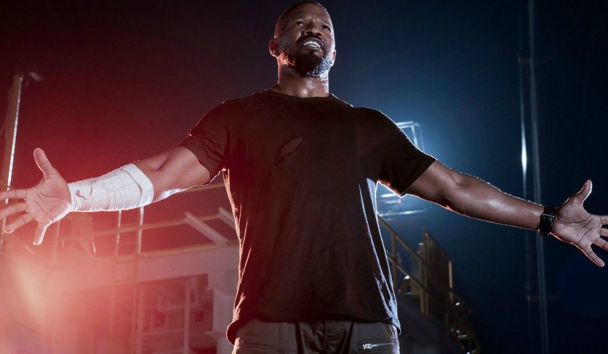 Project Power Jamie Foxx stands arms open on the deck of The Genesis