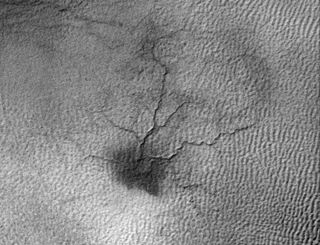 """This image by NASA's Mars Reconnaissance Orbiter shows a network of cracks that may be growing into a larger feature dubbed a """"spider."""""""
