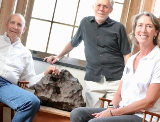Drew Barringer (left), owner of the Arizona Meteor Crater, his wife Clare Schneider, and author William Herbst in the Van Vleck Observatory Library at Wesleyan University, where an iron meteorite is exhibited from the crater.