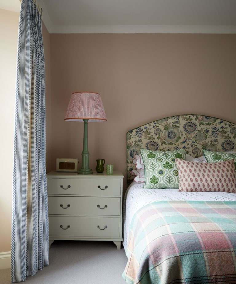 bedroom with pink walls and patterned headboard in Edinburgh Georgian townhouse designed by Jessica Buckley