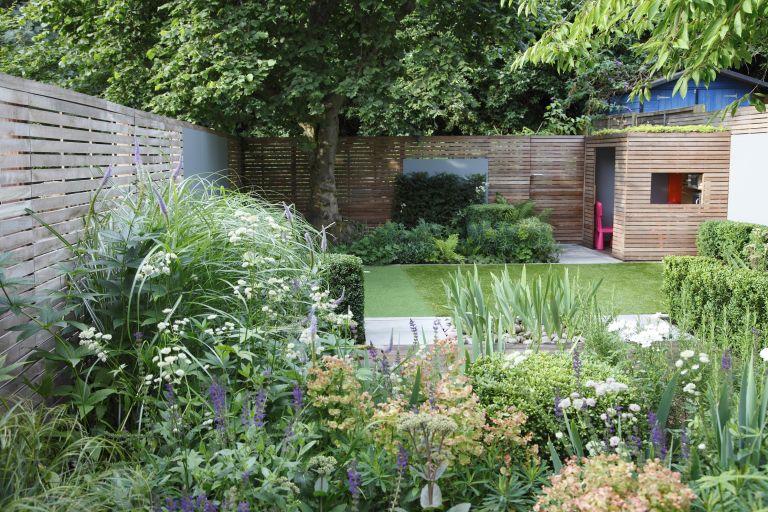 family garden ideas: playhouse at end of garden