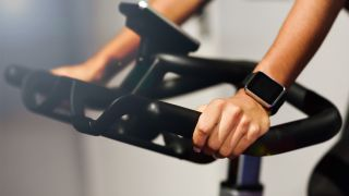 Recumbent bikes vs upright bikes: What's the difference? Image of hands on bike handlebars