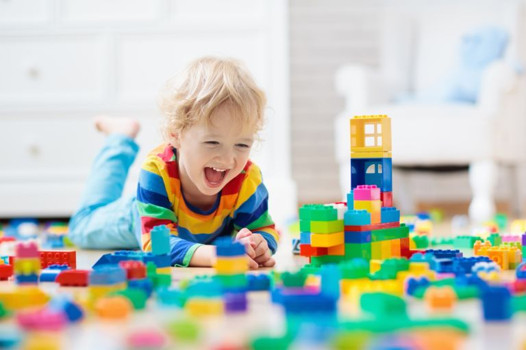 Argos toys: child on floor playing with Lego