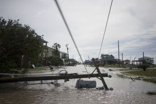 Floods and downed power lines surround damaged homes in Holly Beach, Louisiana after Hurricane Laura came ashore Aug. 27.