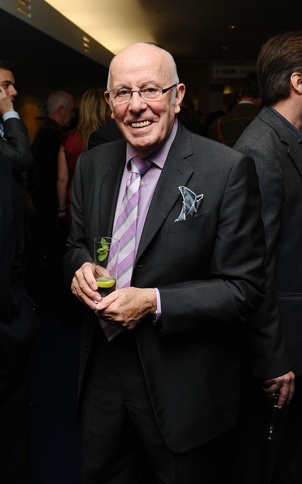 Richard Wilson enjoys a drink at a theatre reception