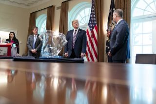 NASA Administrator Jim Bridenstine (right) shows President Donald Trump technology the agency has developed to fight the coronavirus pandemic, including a sterilization device and an oxygen hood, on April 24, 2020.