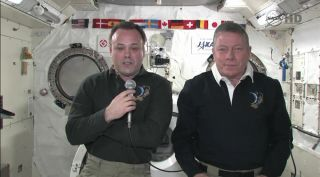 International Space Station astronauts Ron Garan (left) and Mike Fossum talk to reporters Sept. 6.