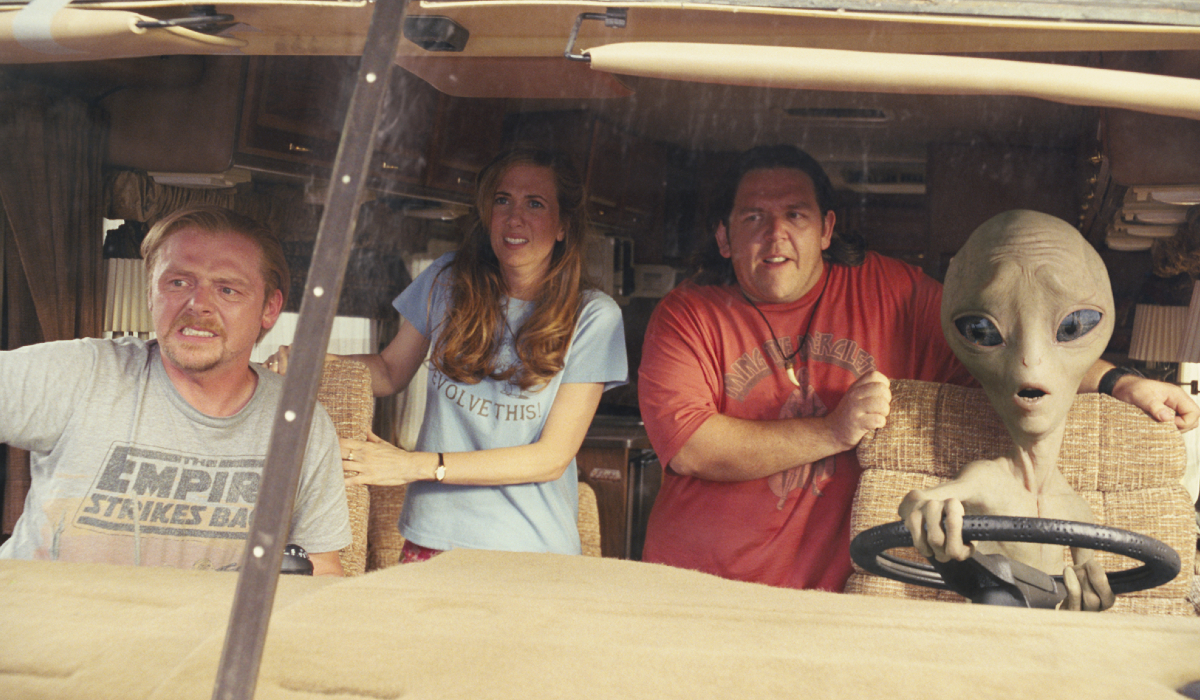Paul Simon Pegg, Kristen Wiig, and Nick Frost ride in an RV with an alien
