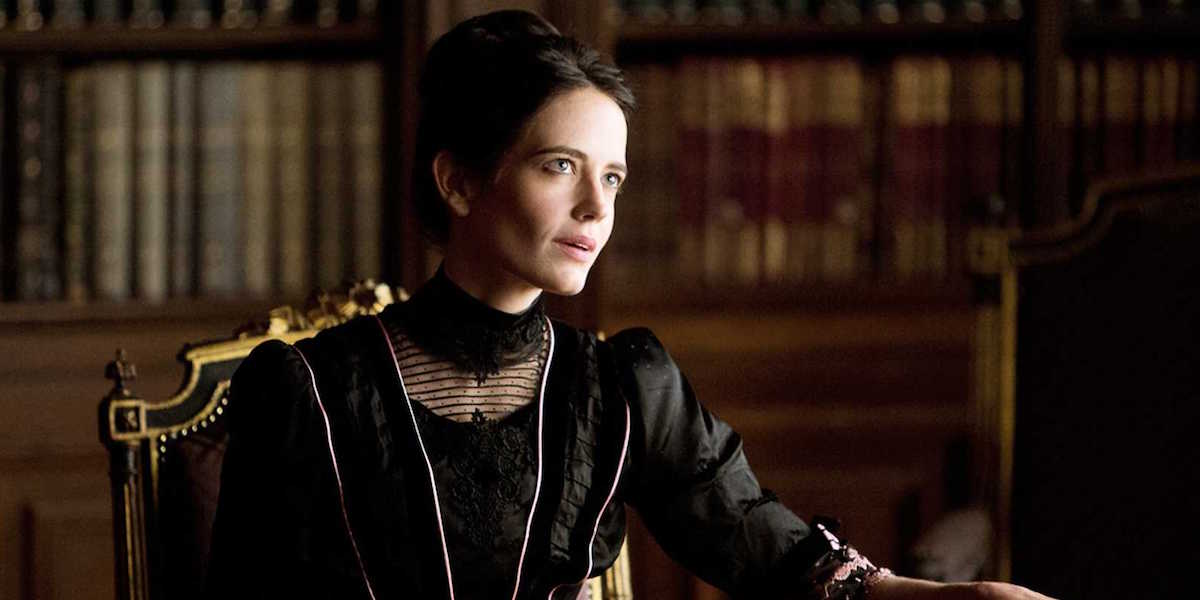 Vanessa Ives (Eva Green) sits at an ornate chair in a library in Penny Dreadful