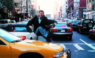 Mel Gibson dashes after the bad guy