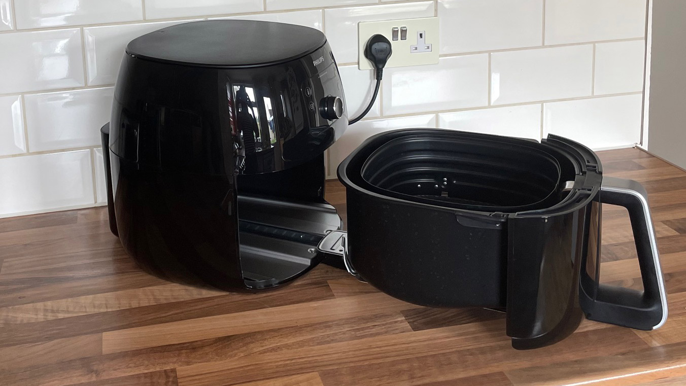 The drawer of the Philips Airfryer XXL HD9650/99 extended on its runners