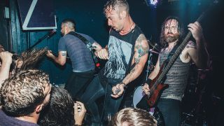 A photograph of Dillinger Escape Plan on stage