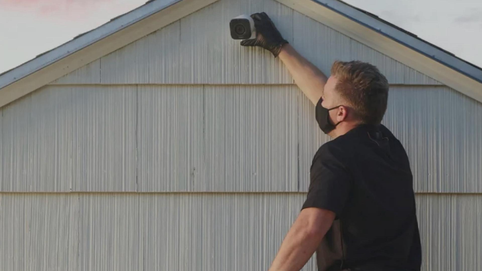 Man installing a Vivint camera