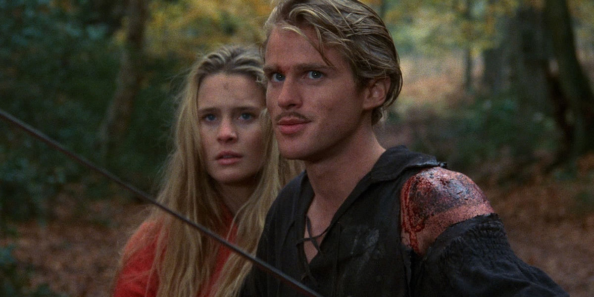 Westley (Cary Elwes) brandishes his sword while standing in front of Buttercup (Robin Wright) in 'The Princess Bride'