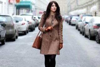 A young woman walks down a street