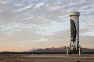Blue Origin's reusable New Shepard booster first stage stands atop a pad following its successful landing during an unmanned test flight from West Texas that launched up to suborbital space and returned safely to Earth on Nov. 23, 2015.