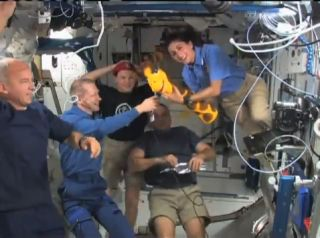 Station Astronauts May Take Shelter From Space Junk