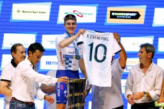 Deceuninck-QuickStep's Remco Evenepoel is gifted an Argentina national football jersey on the podium
