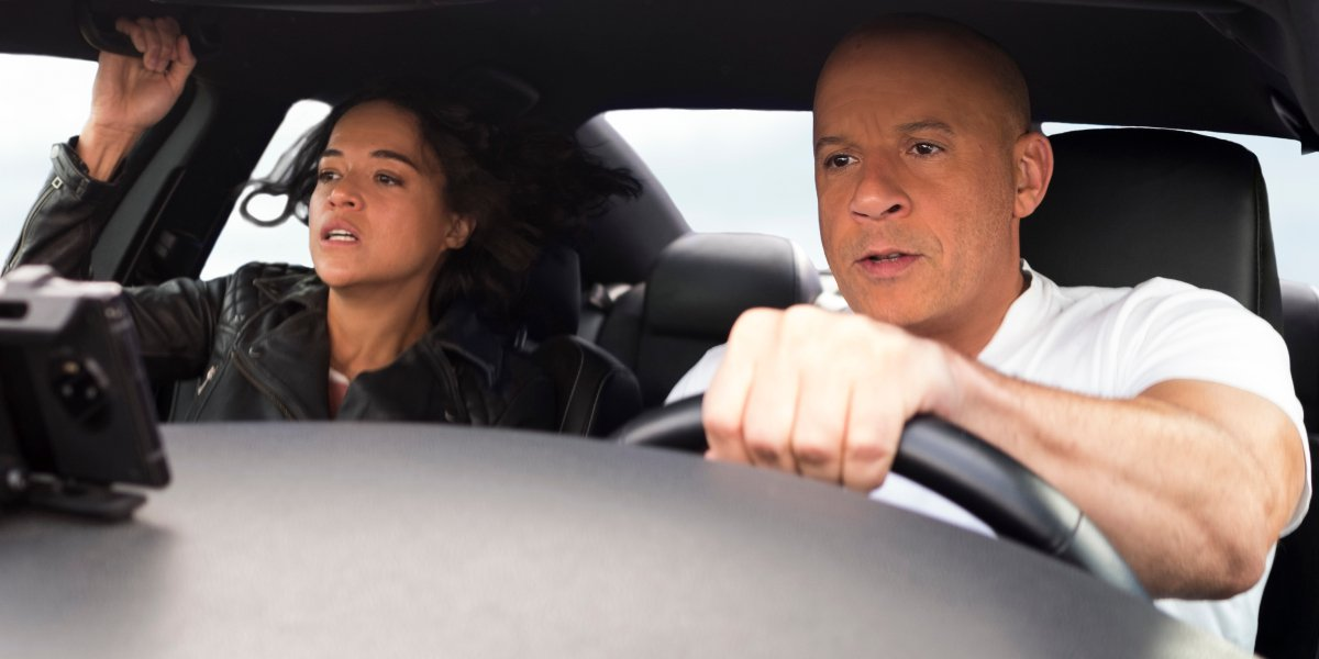 Michelle Rodriguez and Vin Diesel driving hard in F9.