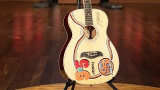 """Dolly PArton is auctioning a """"9 to 5"""" Oscar Schmidt acoustic"""