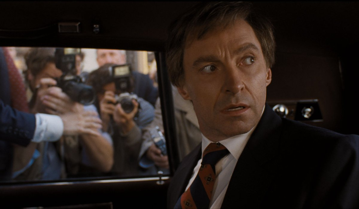 The Front Runner Hugh Jackman looks over his shoulder, in a limo surrounded by cameras