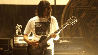 Adam Jones of Tool performs live in 1997