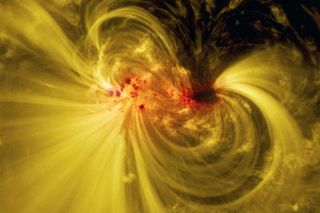 This composite view of sunspot AR12665 is composed of visible and extreme ultraviolet light imagery captured by NASA's Solar Dynamics Observatory.