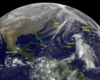 Atlantic and Pacific low pressure systems seen in a GOES satellite image
