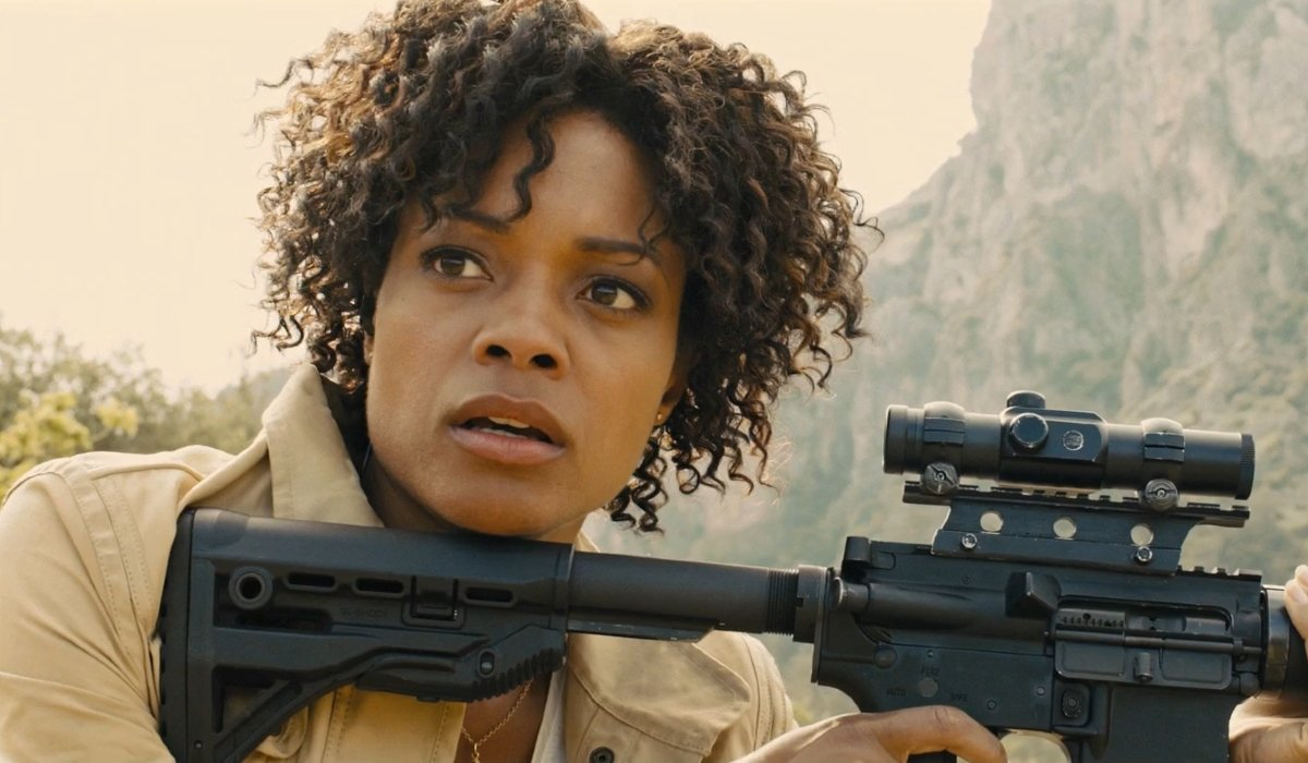 Skyfall Eve Moneypenny in the field, with her rifle